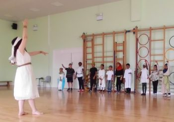 Woman teaches children Ancient Egyptian dance